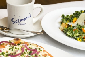 Salmon flatbread, salad, and coffee cup at Cafe Selmarie.