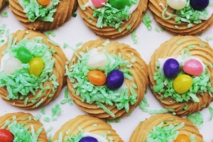 Rows of Easter butter cookies, decorated with icing, green coconut, and jellybeans.