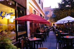 Customers dine on Cafe Selmarie's outdoor patio at dusk
