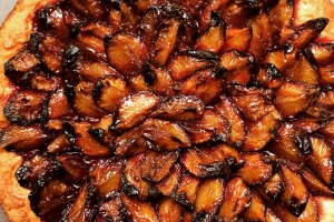 German plum cake (pflaumenkuchen), which is yeasted cake topped with Italian prune plums and cinnamon.