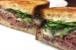 Roast beef, arugula, red onions, and provolone on griddled sourdough bread.