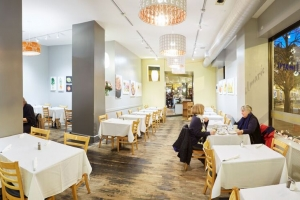 Two women dine in Cafe Selmarie's dining room.