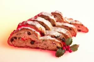Slices of stollen with a sprig of holly.