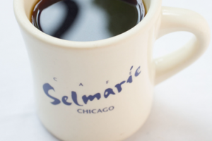 Black coffee in a Cafe Selmarie coffee mug.