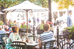 Customers have brunch on Cafe Selmarie's outdoor patio overlooking Giddings Plaza.
