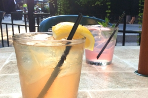 Two cocktails in rocks glasses on Cafe Selmarie's outdoor patio.