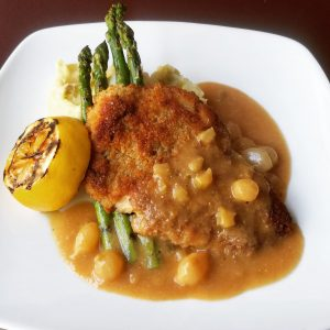 Chicken schnitzel with asparagus, mashed potatoes, and gravy