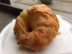 Plain croissant on white plate