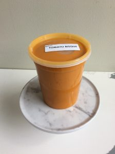 Quart container of tomato bisque