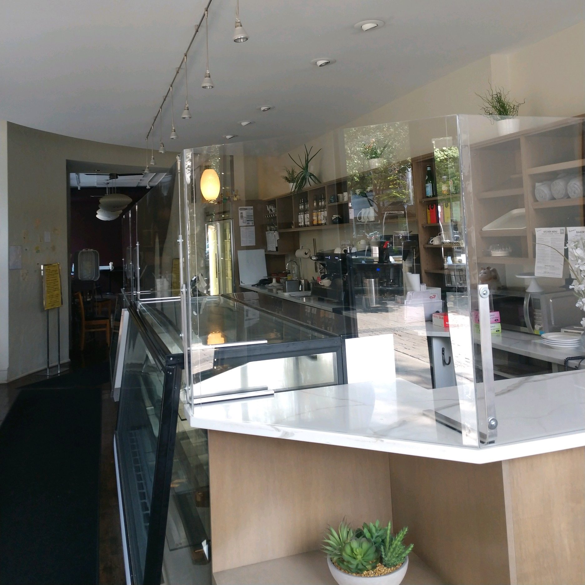 Bakery counter with plexiglass partitions