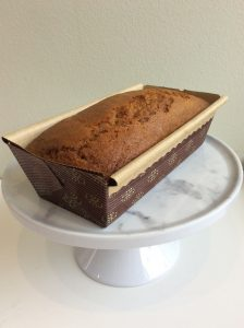 Loaf of pumpkin bread on a marble cake stand