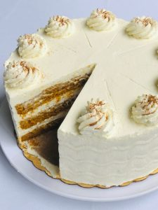 Pumpkin tres leches torte with one slice removed